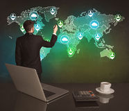 Salesman drawing on world map at office Royalty Free Stock Images