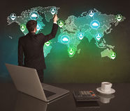 Salesman drawing on world map at office Royalty Free Stock Photography
