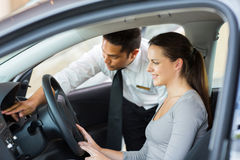 Salesman Explaining Car Features Customer