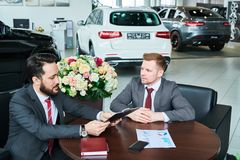 Salesman with the client at salon royalty free stock photography