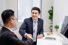 Salesman explaining his idea of overcoming crisis to co-worker stock images