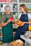 Salesman With Female Colleague Working In Royalty Free Stock Image