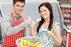 Salesman giving apples to his happy customer Royalty Free Stock Image