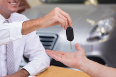 Salesman giving a customer car keys Royalty Free Stock Photo