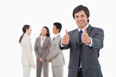 Salesman giving his approval with team behind him Stock Photography