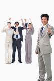 Salesman giving thumb up while getting celebrated Royalty Free Stock Photo