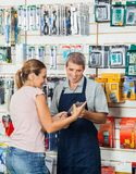 Salesman Guiding Customer In Hardware Store Stock Images