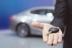 Salesman handing over gives businessman the car key stock photography