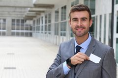 Salesman handing you a business card.  Royalty Free Stock Images