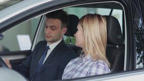 Salesman hands over the keys to the buyer stock video footage