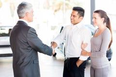 Salesman handshaking couple Royalty Free Stock Image