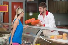 Salesman Helping Beautiful Woman To Choose royalty free stock photo
