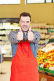 Salesman holding both thumbs up Stock Photography