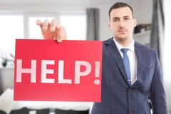 Salesman holding text with help stock images