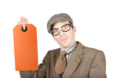 Salesman holding large copy space price tag Stock Image
