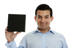 Salesman holds product, book or other merchandise Royalty Free Stock Image