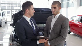 Salesman in a motor show stock video