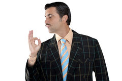 Salesman occupation tacky man ok gesture profile. Salesman occupation mustache man profile view with tacky suit and ok gesture in hand stock images