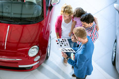 Salesman offering a car to family Stock Image