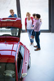 Salesman offering a car to family Stock Images