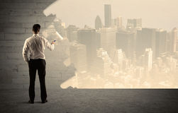 Salesman painting city scape on wall Royalty Free Stock Photography