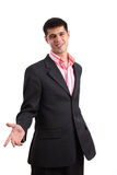 Salesman persuasion. Smiling businessman with an empty hand persuading somebody stock image