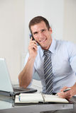 Salesman on the phone Stock Image