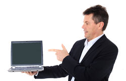 Salesman points at laptop stock photo