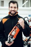 Salesman is posing with new disc grinder in power tools store. royalty free stock photography