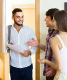 Salesman presents his project standing near the entrance door Stock Photo