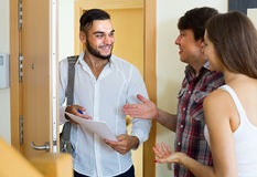Salesman presents his project standing near the entrance door Royalty Free Stock Photos
