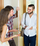 Salesman presents his project standing near the entrance door Royalty Free Stock Photo