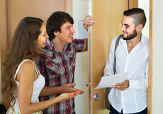 Salesman presents his project standing near the entrance door Royalty Free Stock Images