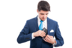 Salesman pulled out his inside jacket pocket wallet. To pay what he bought on white background Royalty Free Stock Image