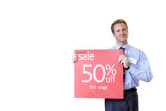Salesman with 'sale' sign, smiling, portrait, cut out Stock Photo