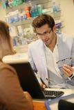 Salesman selling eyeglasses Stock Photos