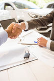 Salesman shaking a customer hand Royalty Free Stock Photo