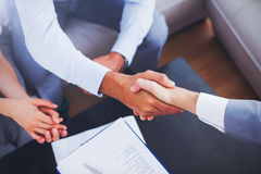 Salesman shaking hands with client Stock Images