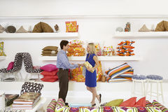 Salesman Shaking Hands With Female Customer. Salesman in home furnishings store shaking female customer's hand stock images