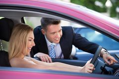 Salesman showing car to customer Stock Photography
