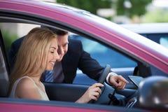 Salesman Showing Car To Customer Stock Photos