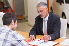 Salesman showing client where to sign the deal Stock Images