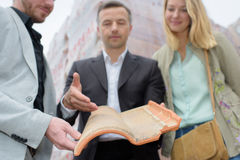 Salesman showing couple modern rooftile Stock Images