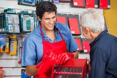 Salesman Showing Drill Bit To Man In Store Stock Images