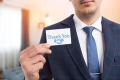 Salesman showing gratitude with business card stock image