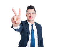 Salesman showing number two peace or victory gesture Stock Photo