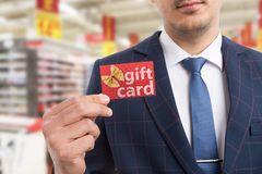 Salesman showing gift card royalty free stock photography