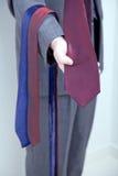 Salesman showing ties Royalty Free Stock Image
