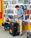 Salesman Showing Tool Case To Customer In Store Royalty Free Stock Photography