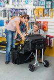 Salesman Showing Tool Case To Customer In Store Royalty Free Stock Images
